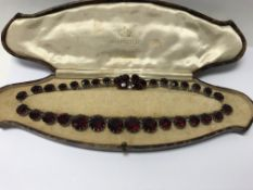 A Christian Dior necklace set with red stones , se