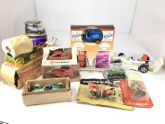 A collection of toy cars and a Delprado figure. In