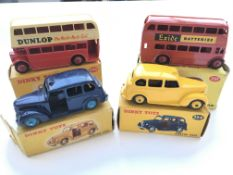 2 boxed Austin Taxis #251 one blue and one yellow,