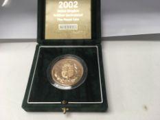 A 2002 gold five pound coin .