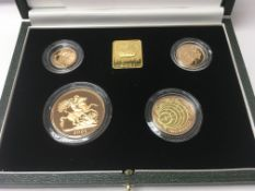 A gold proof 2001 sovereign set (4) comprising £5