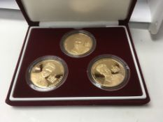 A set of Three commemorative £5 gold coins Prince