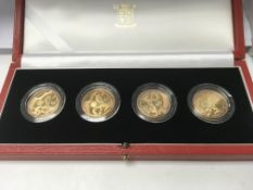 A case set of four gold £2 coins, 2002 commonwealt