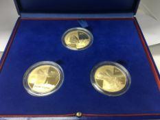 A cased set of 3 Monnaie De Paris gold (17 grams e
