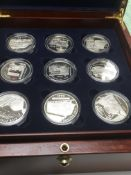 A cased set of 18 British railways £5 silver proof