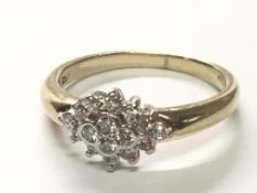 A 9carat gold ring set with a pattern of sixteen brilliant cut diamonds.ring size P.