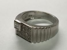 A Gents white gold ring set with a pattern of diamonds. Ring size U.