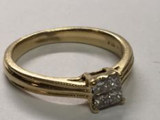 An 18carat gold ring set with a square pattern of Princess cut diamonds approximately 0.25 of a