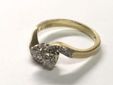An 18carat gold ring diamond cross over with further diamonds to the shank. ring size K.