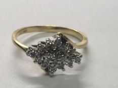 An 18carat gold ring set with a cluster of diamonds ring size H.