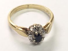 An 18carat gold ring set with a blue sapphire and chip stone diamonds ring size K.