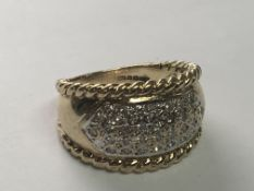 A 9carat gold diamond cluster ring with a rope twist edge. Ring Size N.