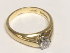 An 18carat gold ring set with a brilliant cut solitaire diamond approximately 0.25 of a carat.