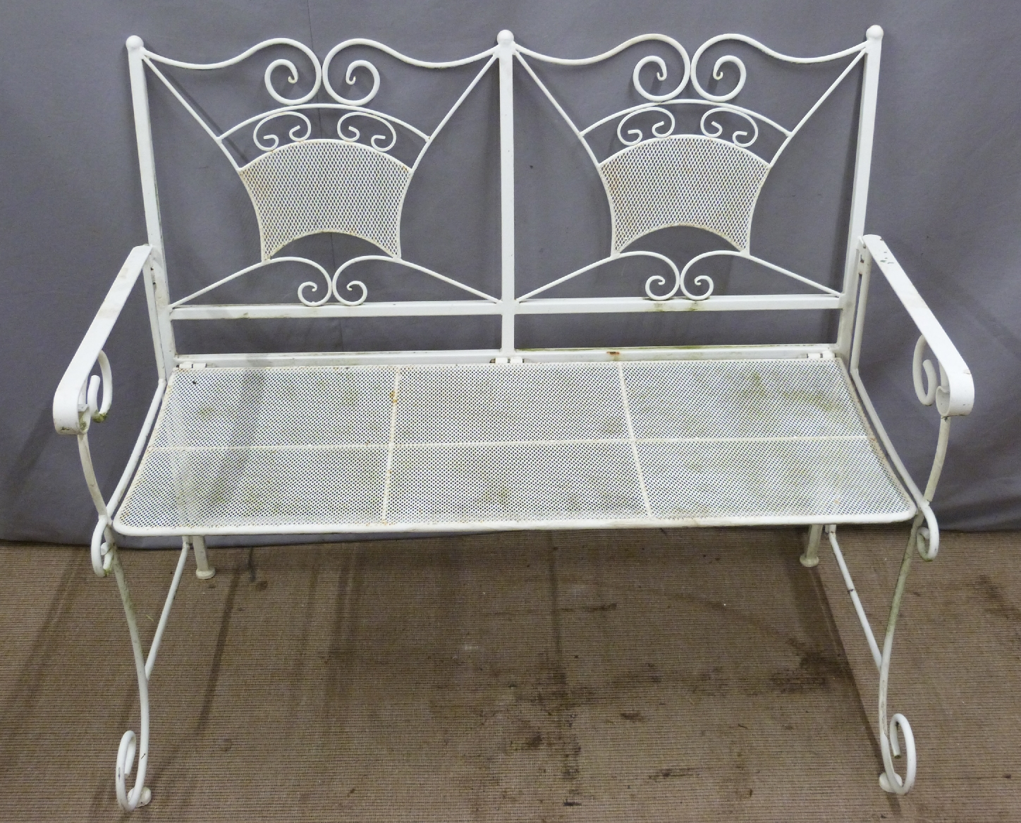 Lot 1382 - White painted wire work garden table, bench and two chairs, length of bench 114cm