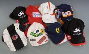 Eight motor racing caps, each signed by a Formula 1 driver including Jensen Button, Felipe Massa,