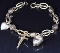 A 9ct gold charm bracelet, 11.3g