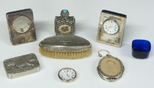 Two hallmarked silver mounted Kitney & Co. dressing table clocks, hallmarked silver mounted brush,