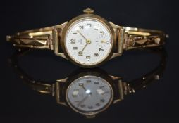 Tudor 9ct gold ladies wristwatch with inset subsidiary seconds dial, gold hands and Arabic numerals,