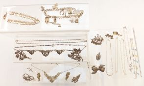 A group of silver jewellery including charm bracelet, curb link bracelet, chains, necklace, brooches