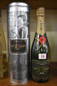 A bottle of Moet 1998 vintage Millesime Blanc champagne, in metal tin.