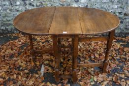 An old oak two flap table. This lot can only be collected on Saturday 19th December (9-2pm).