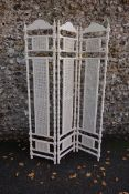 A white painted cane three fold screen, 184cm high. This lot can only be collected on Saturday