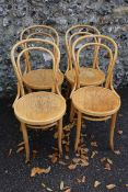 A set of four Thonet style bentwood chairs. This lot can only be collected on Saturday 19th December