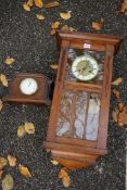 A mahogany hanging wall clock; together with an oak mantel clock. This lot can only be collected
