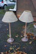A pair of modern table lamps, with twist stems. This lot can only be collected on Saturday 19th