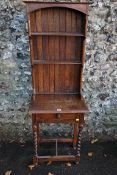 An antique oak dresser having two shelves. This lot can only be collected on Saturday 19th