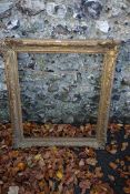 An old gilt picture frame, aperture 59 x 69cm, together with an old map of Hampshire. This lot can