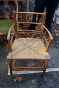 An antique beech and rush seated Sussex chair. This lot can only be collected on Saturday 19th