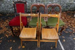 A pair of folding chairs; and three dining chairs. This lot can only be collected on Saturday 19th