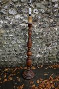 A stained wood standard lamp. This lot can only be collected on Saturday 19th December (9-2pm).