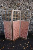 An Edwardian three fold screen with glass and pink floral fabric panels, 151cm high. This lot can