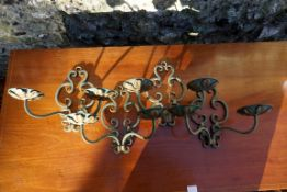 Four matching wrought iron wall tealight holders. This lot can only be collected on Saturday 19th