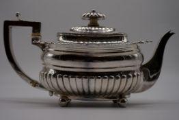 A George III silver teapot, by J W Story & W Elliott, London 1810, 13cm high, 756g gross weight.