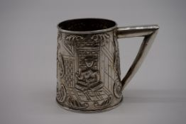 A Malaysian white metal tankard,decorated figure and rhyme, 8cm high.