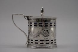An Edwardian pierced silver drum mustard, by William Aitkin, Chester 1901, having bright cut