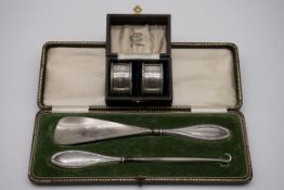 A cased pair of silver napkin rings, by John Rose, Birmingham 1968, 37g; together with a cased
