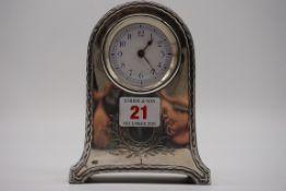 An Edwardian silver timepiece,byWilliam Comyns, London 1906, 14cm high.