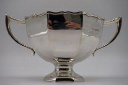 An Edwardian silver twin handled fruit bowl, by Horace Woodward & Co Ltd, London 1908, 26cm