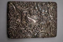 An Edwardian embossed silver card case, by Robert Pringle & Sons, Birmingham 1904, 7 x 10cm, 49.5g.
