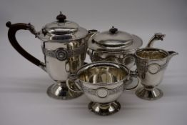 An Irish silver Celtic Revival three piece tea set, by Mappin & Webb Ltd, Dublin 1917; together with