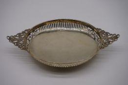 An Edwardian pierced silver twin handled fruit bowl, by Josiah Williams & Co, Jackson & David