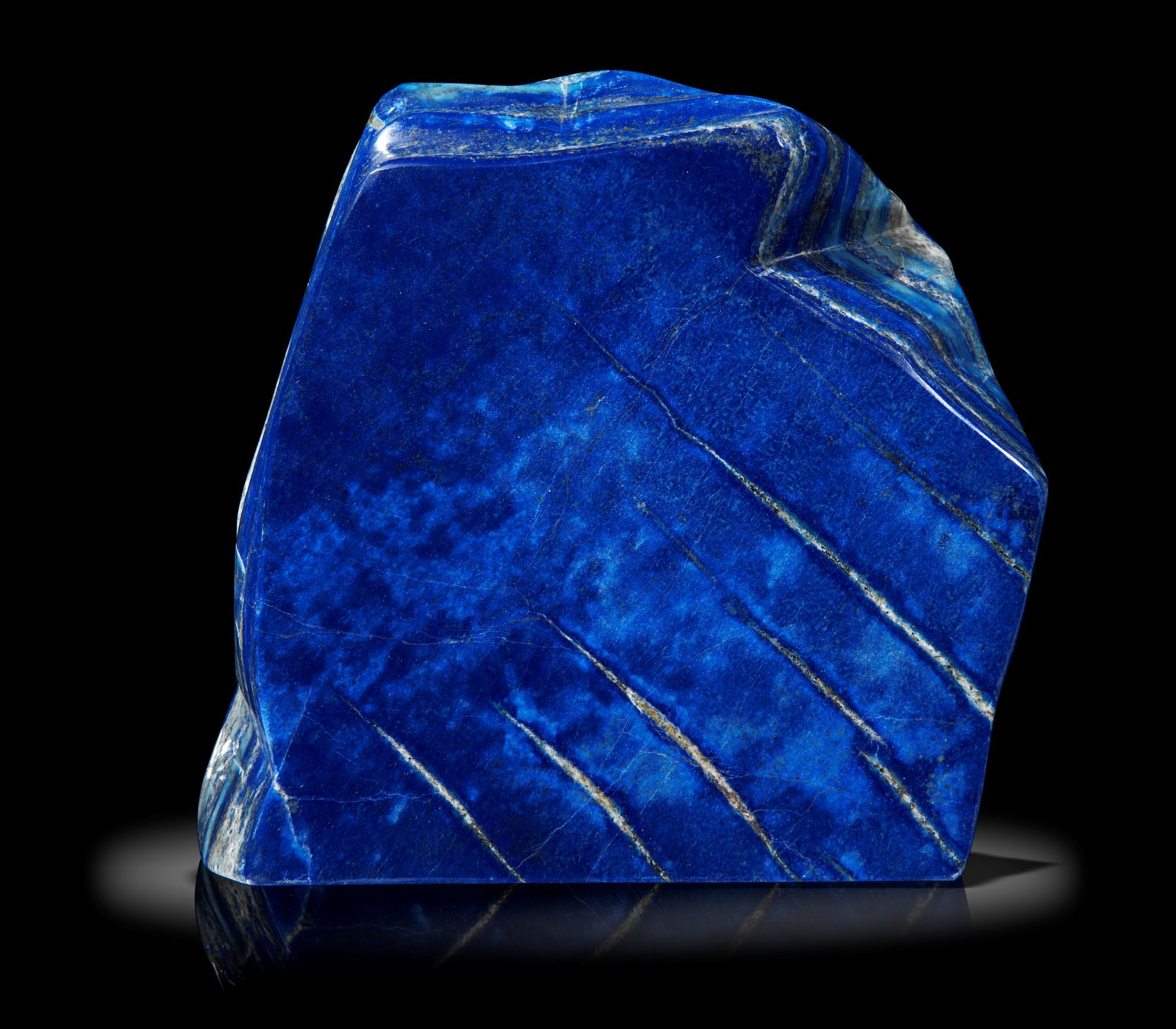 Lot 23 - Interior Design/Minerals: A Lapis lazuli freeform, 19cm high by 18cm wide by 6cm deep, 4.5kg