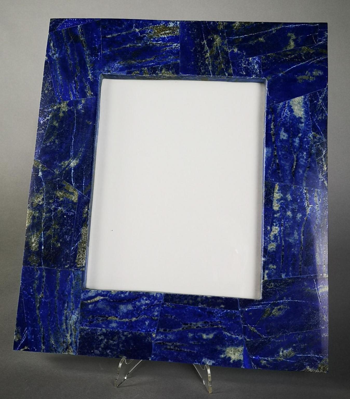 Lot 25 - Interior Design/Minerals: A Lapis lazuli veneered picture frame, 37cm high by 31cm high