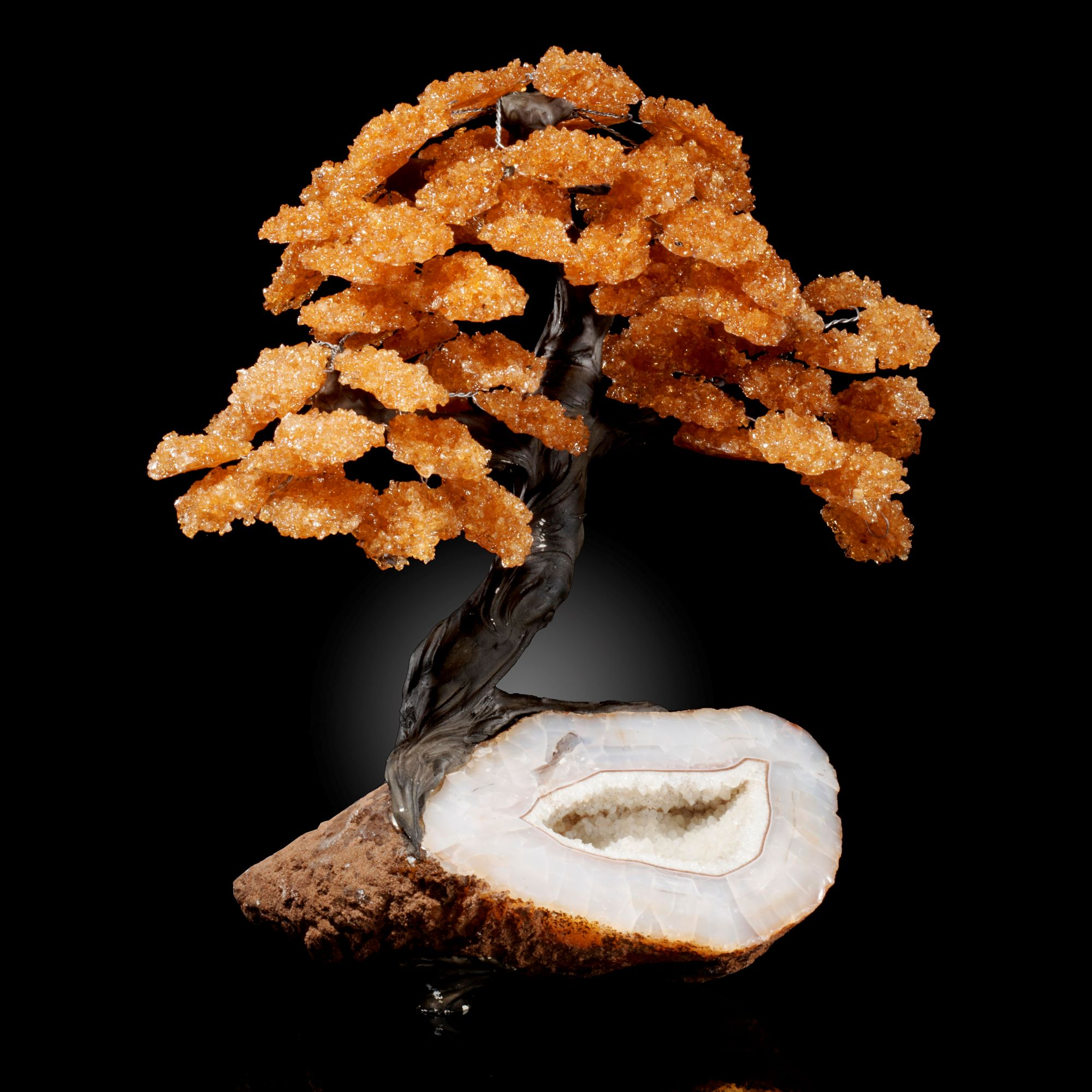 Lot 8 - Interior Design/Minerals: A large citrine tree on natural geode base, 40cm high by 25cm wide