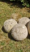Gate piers: A set of four carved Cotswold stone balls, 23cm diameterThe Cotswold Collection. See lot