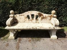 Garden Seats: A near pair of Arts and Craft carved Cotswold stone seats, early 20th century, 176cm